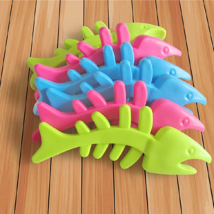 宠物用品tpr宠物玩具鱼骨耐咬橡胶狗狗玩具磨牙宠物玩具糖果色图片