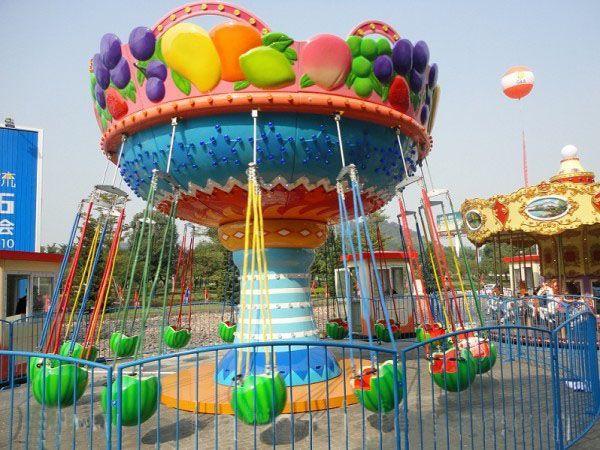 儿童游乐场游乐设备西瓜飞椅_16座旋转水果飞椅_郑州大洋水果旋风示例图3